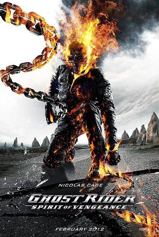 The Rider stands, fire shooting out of his head, the Rider's signature chains arcing in front of him