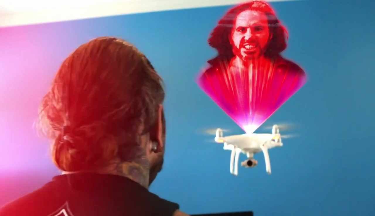 Jeff Hardy is confronted by a drone projecting a holographic image of Broken Matt Hardy