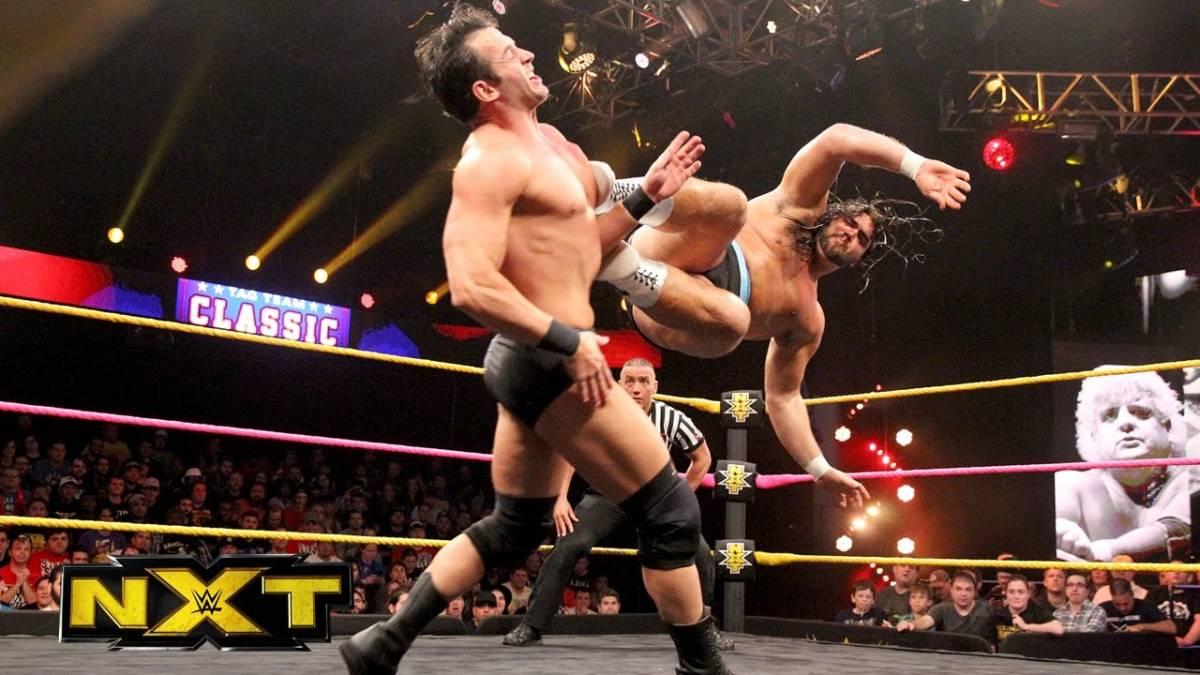 Tucker Knight delivers a dropkick to Roderick Strong