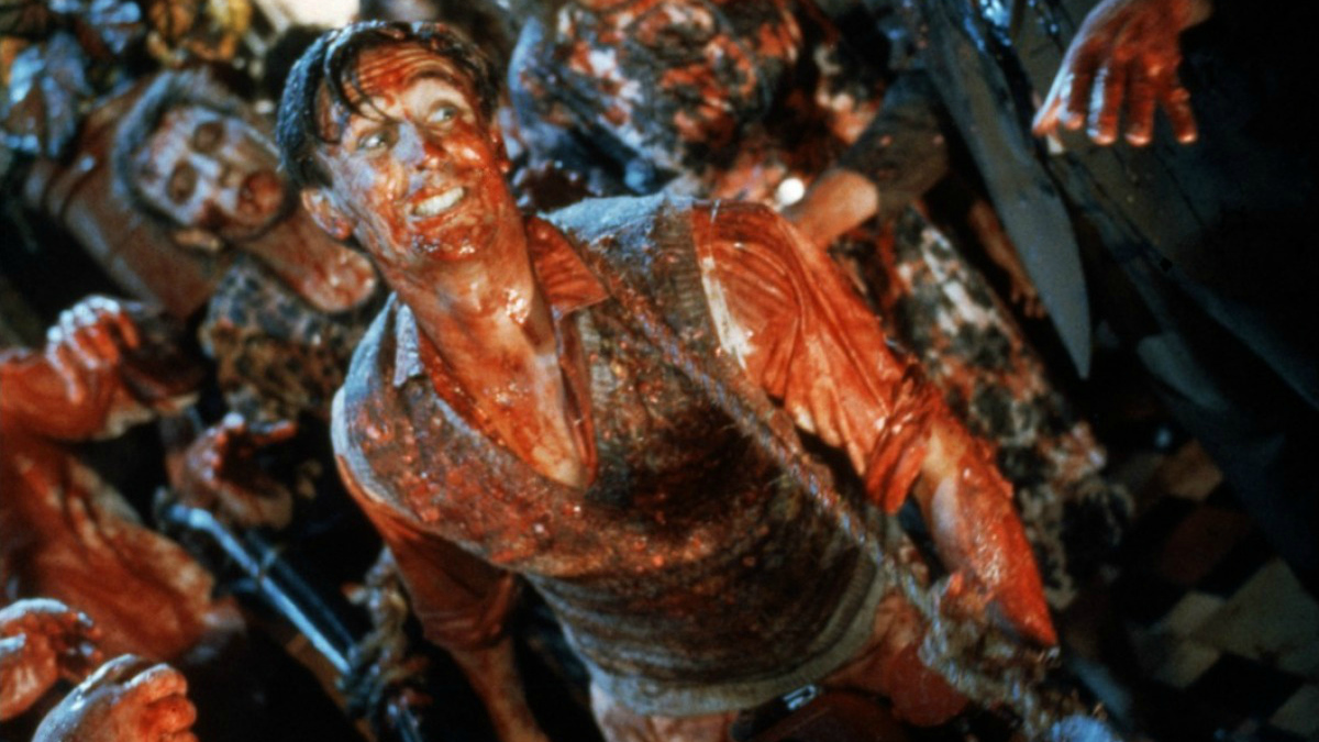 The main character of Dead Alive Lionel Cosgrove (Timothy Balme) stands in the midst of zombies, his smart sunday dinner clothes drenched in the blood of the undead he has already killed
