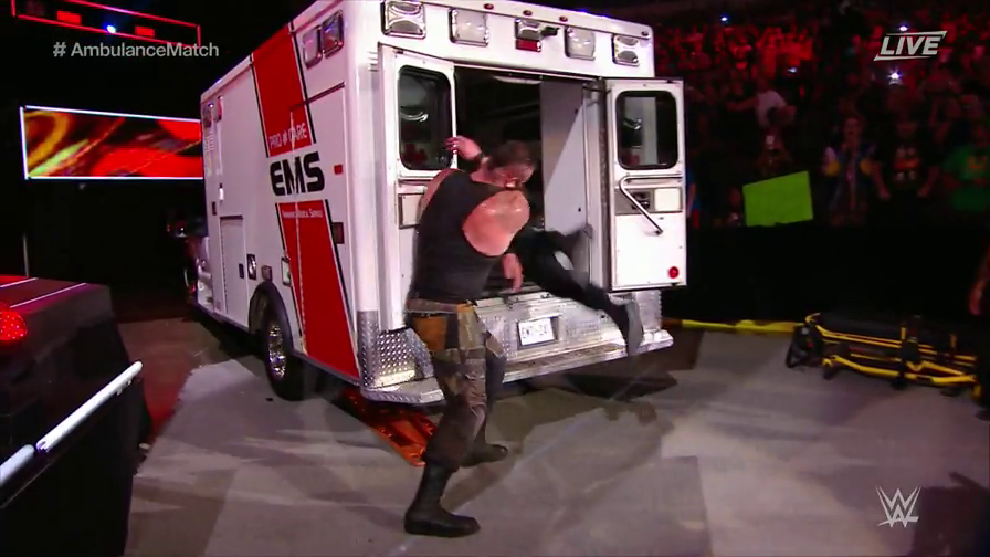 Roman Reigns vs Brawn Strowman in an ambulance match where Reigns has attempted to spear Strowman but has missed causing himself to go flying into the back of the ambulance like a big dummy