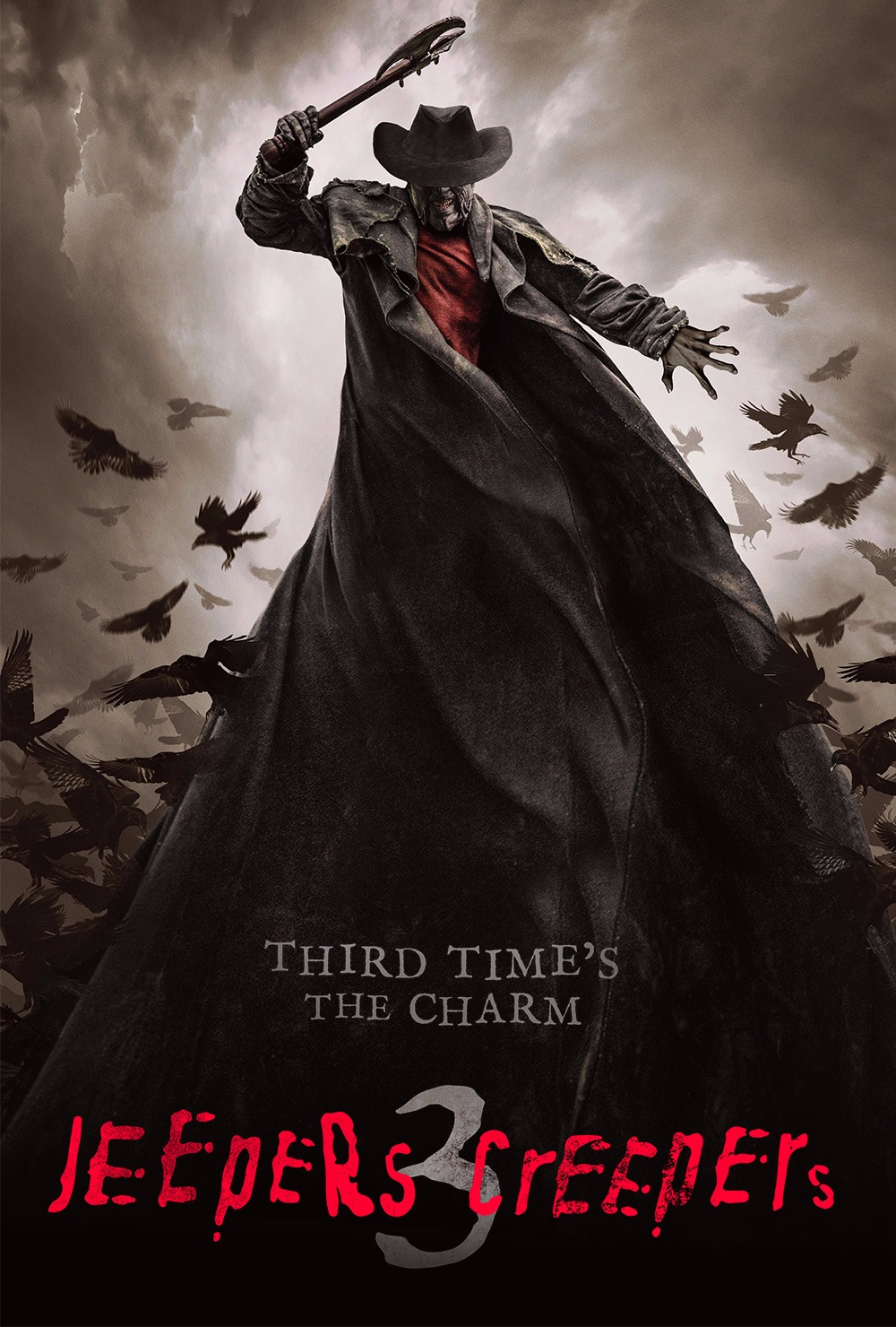 "The Creeper looms large as he raises his axe above his head, his coat flapping around him as it takes over the lower half of the frame. The tagline says ""Third time's the charm"""
