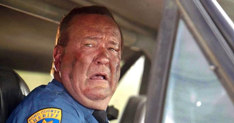 The image shows Sgt Tubbs played by Brandon Smith reprising his role from the first film he looks out through the window of a pickup truck with a sad and disturbed expression on his face that he has for basically the entire film